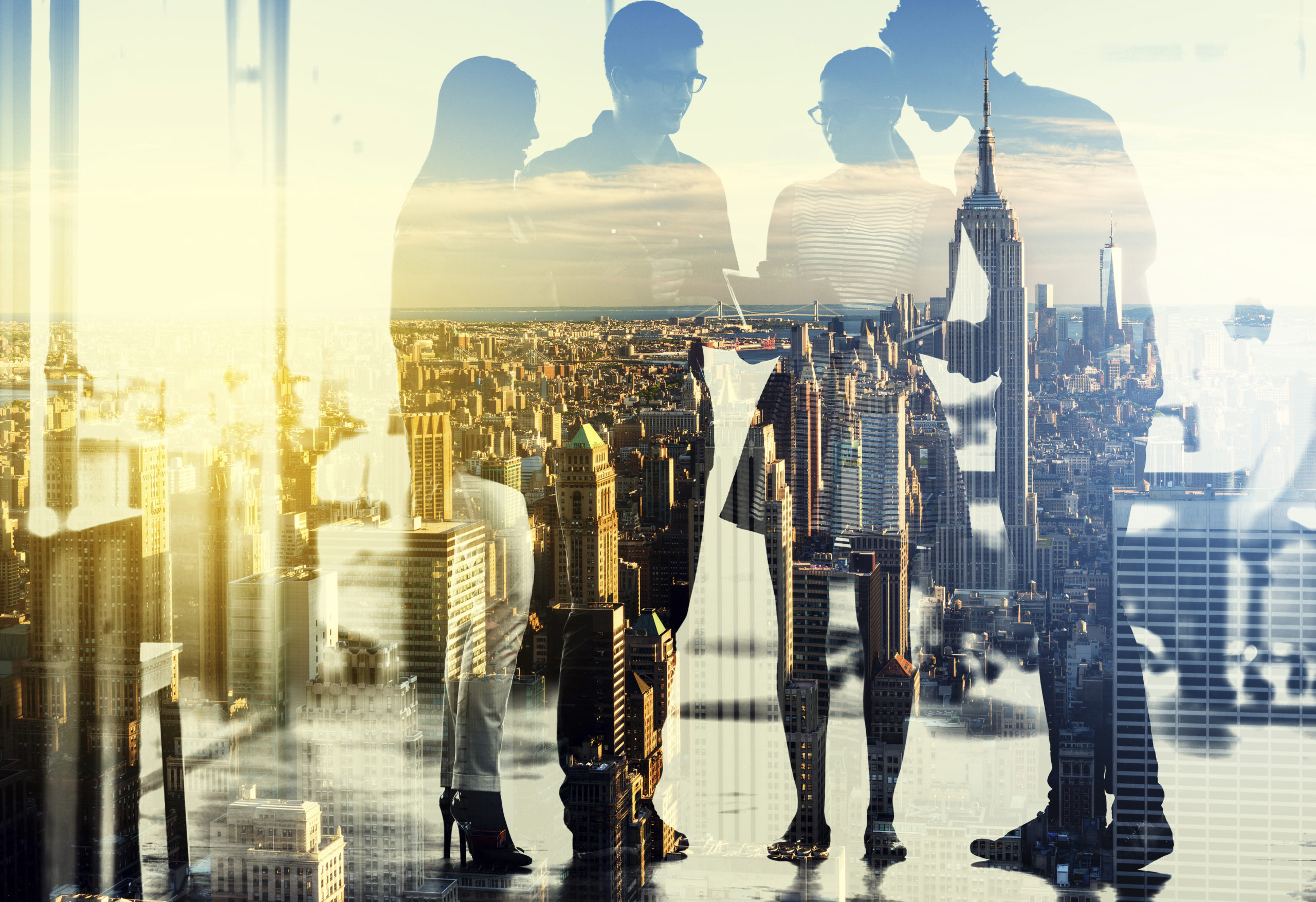 Two men and two women standing in from of a transparent city landscape background--Contact Us.