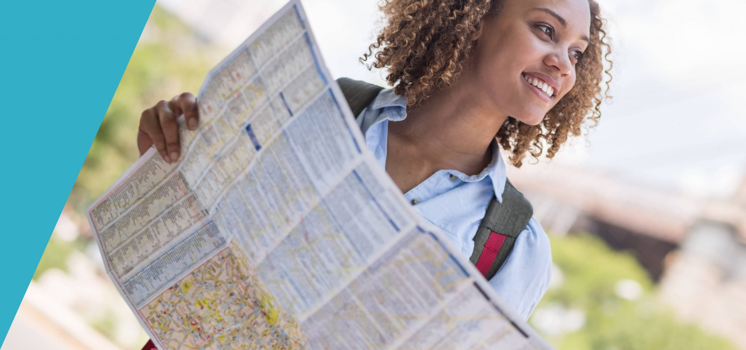 A woman holding a map and thinking Business Development.