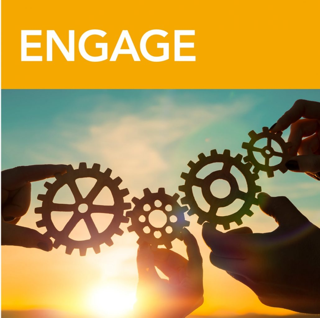 Hands holding gears engaging to represent business development engagement.